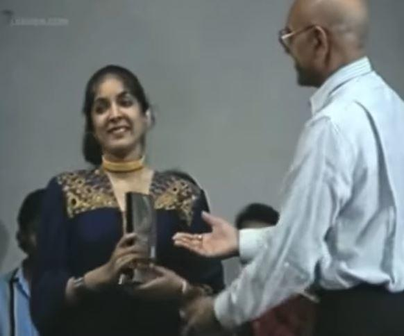 In the video, Neena Gupta is seen donning a navy blue and gold dress. Her hair is tied back, and she is seen wearing a choker around her neck.