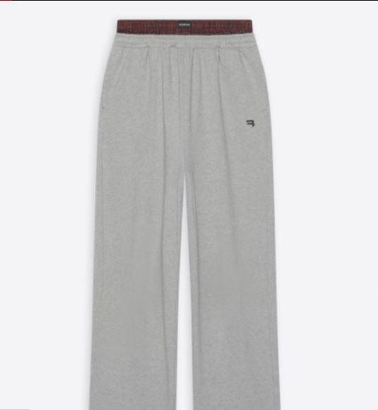 The pants feature a built-in pair of boxers shorts peeking out from the waistband, mimicking the style popularized by hip hop culture in the 1990s.