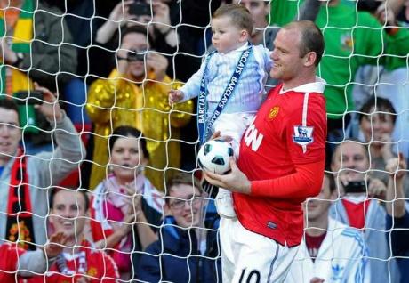 Man U striker Rooney's son Kai is a Barcelona fan!