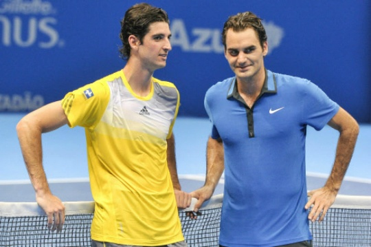 Thomaz Bellucci of Brazil and Roger Federer of Switzerland