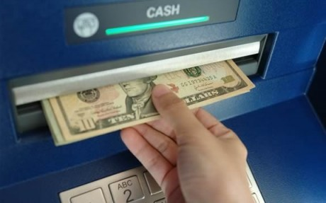 Britons cash in as ATM pays out double