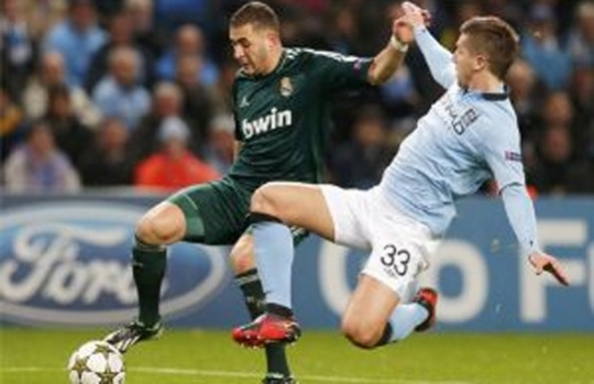 Real Send Man City to Another Early Exit