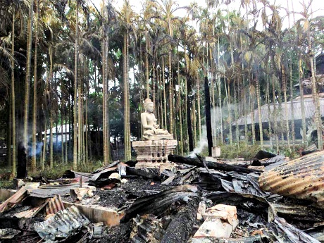 Protesters torch Buddhist temples in Bangladesh