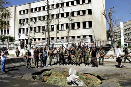 Explosions strike Syrian army building