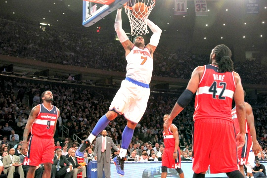 New York Knicks' Carmelo Anthony (7) dunks as Washington Wizards' Nene (42) and Martell Webster (9) watch during the second half of an NBA basketball game