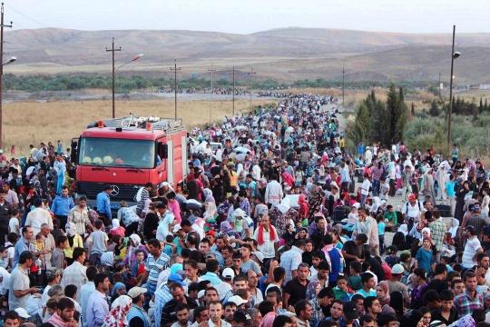 Hungry, Scared Syrian Kurds Flood Iraq
