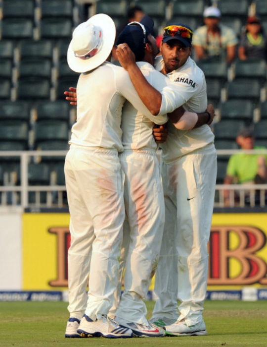 India celebrate after Ajinkya Rahane (centre) ran-out Faf du Plessis which was the turning point in the South African run-chase. (Photo: AFP)