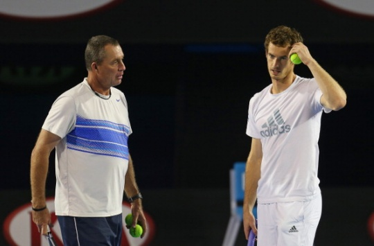 Andy Murray of Great Britain serves as his coach Ivan Lendl looks on in training session. (Getty Images)