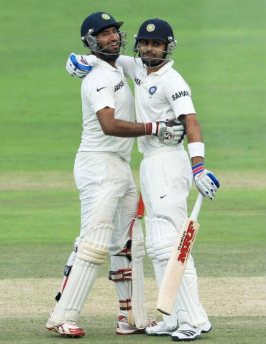 Cheteshwar Pujara (left) and Virat Kohli added an unbeaten 191 for the third wicket on Day Three. (Photo: AP)