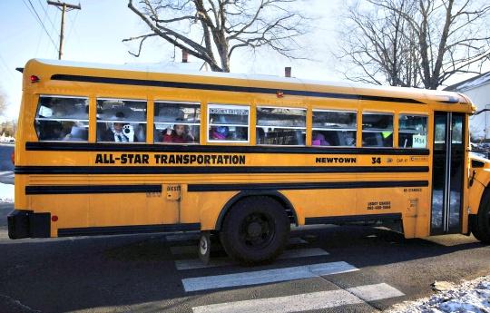 US School Massacre Survivors Return to Class
