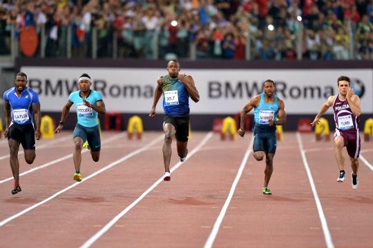 Justin Gatlin Shoots Down Usain Bolt in Rome