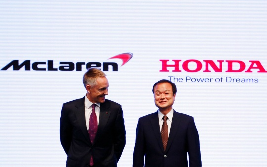Honda Motor Co's President and Chief Executive Officer Takanobu Ito (R) exchanges smiles with with McLaren Group Limited CEO Martin Whitmarsh at their joint news conference in Tokyo