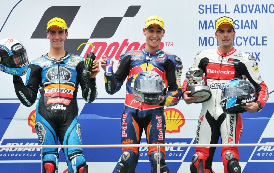Red Bull KTM Ajo's Spanish rider Luis Salom (C), second-placed Estrella Galicia's Spanish rider Alex Rins (L) and third-placed Mahindra Racing Portugal rider Miguel Oliviera