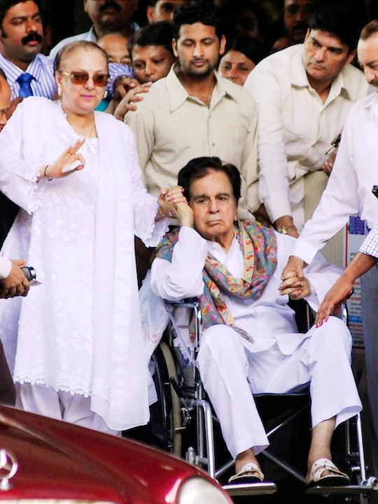 After spending 11 days in hospital actor Dilip Kumar was discharged on Thursday afternoon.  The 90-year-old living legend of Hindi cinema received a grand welcome as he exited Mumbai's Lilavati hospital on a wheel chair along with his wife Saira Banu.