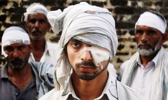 Injured villagers in Muzaffarnagar riots