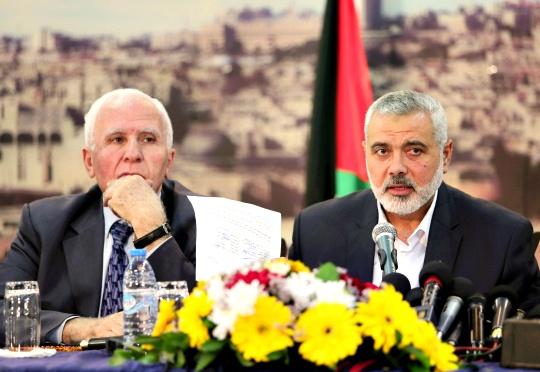 Fatah official Azzam al-Ahmad, Hamas Prime Minister Ismail Haniyeh
