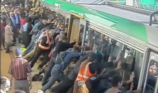 People Push Train to Help Trapped Man