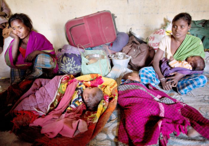 Tribals hiding in a school during Assam violence