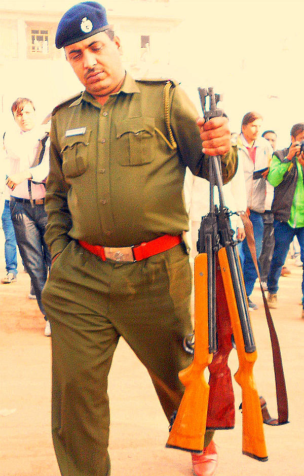 Police with guns from the satlok ashram
