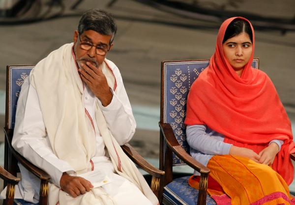 malala and kailash sitting at nobel ceremony