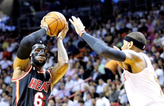 Masked James Leads Heat to Victory