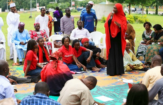A member of Abuja's 'Bring Back Our Girls' protest group speaks in a meeting at the Unity Fountain in Abuja