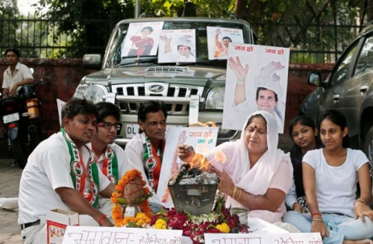 ndia's Congress party workers perform a Yagya for their party