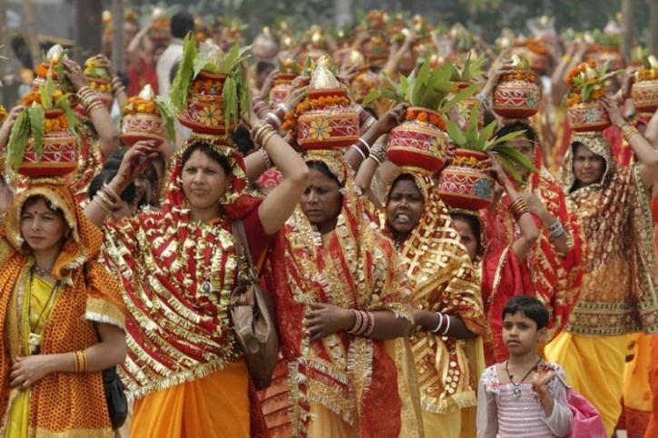 Women carrying earthen pot
