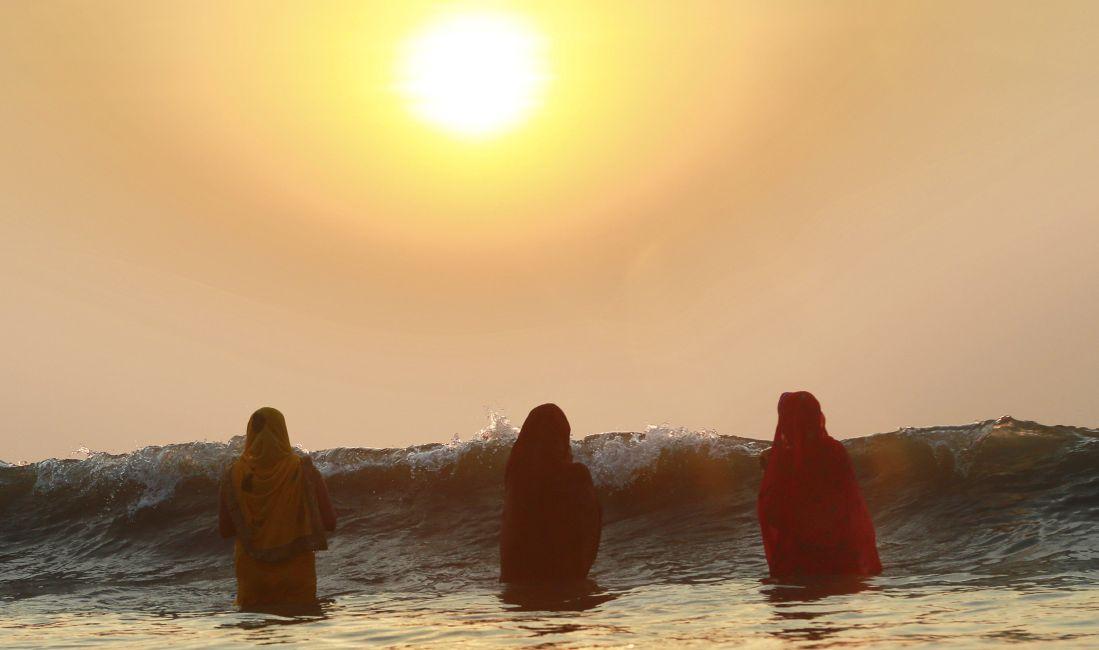 women offer prayers during Chhath Puja festival