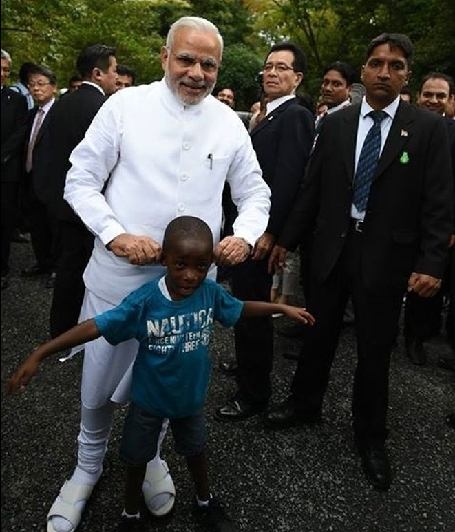 Narendra Modi playing with a child