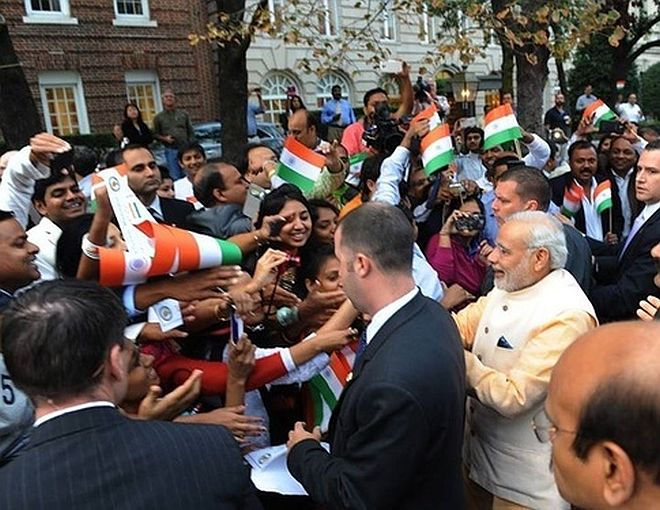 Modi shaking hands with crowd