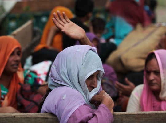 women waiting to leave chilayri region in India