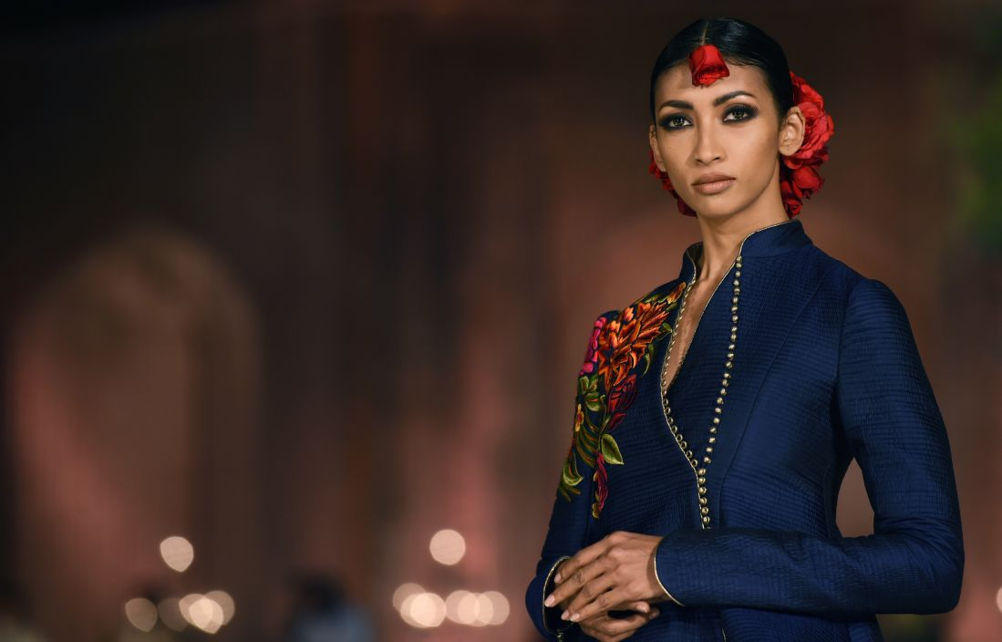 Models present creations by Indian designer Rohit Bal during the Grand Final of the Wills Lifestyle Indian Fashion Week Spring
