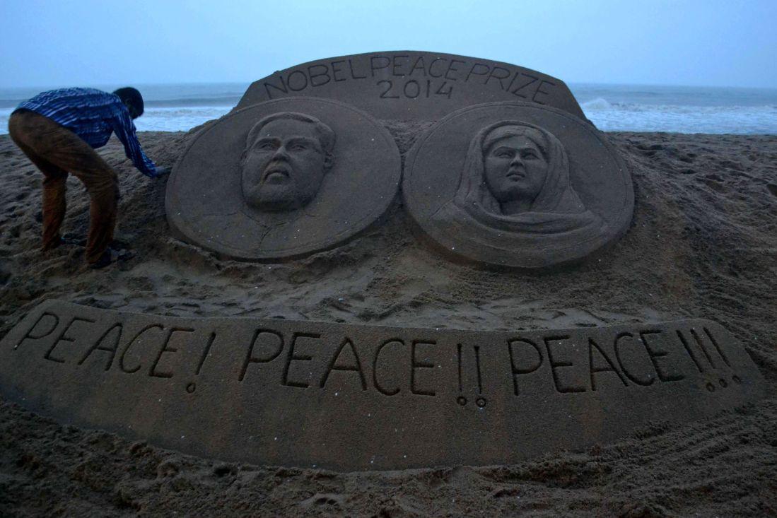 Sand sculpture bearing portraits of Kailash Satyarthi and Malala Yousafzai