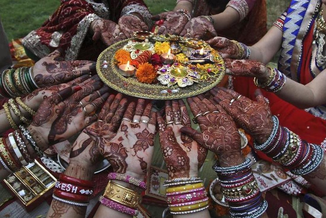 married women perform rituals on Karva Chauth