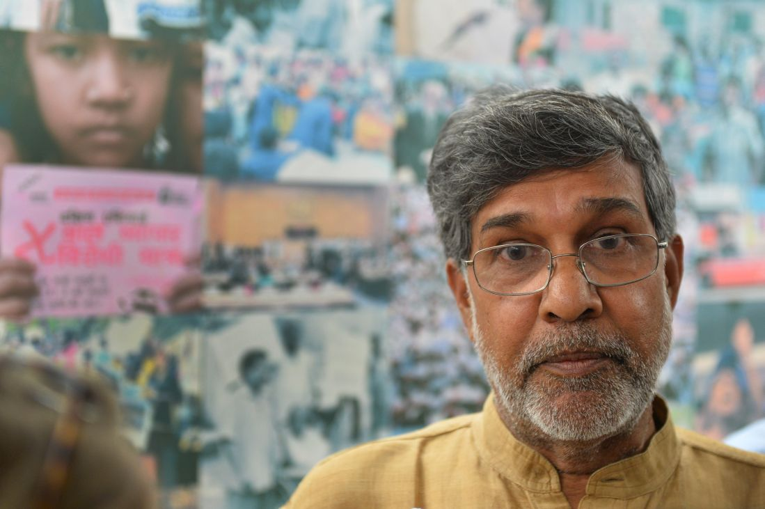 Kailash Satyarthi gestures at his home office