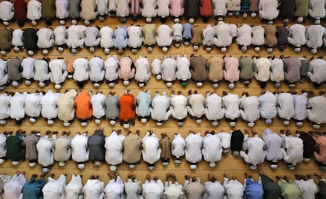 Muslims offer prayers during Eid al-Adha