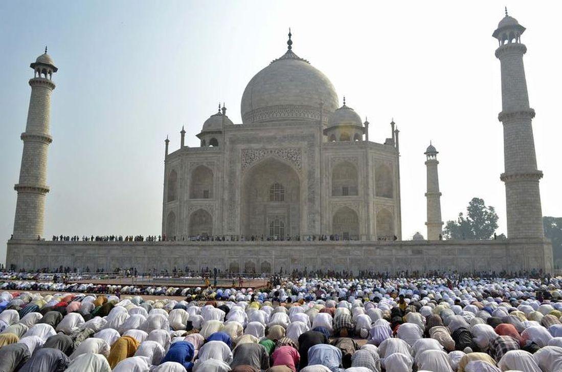 Muslims offer Eid al-Adha prayers in front of Taj Mahal