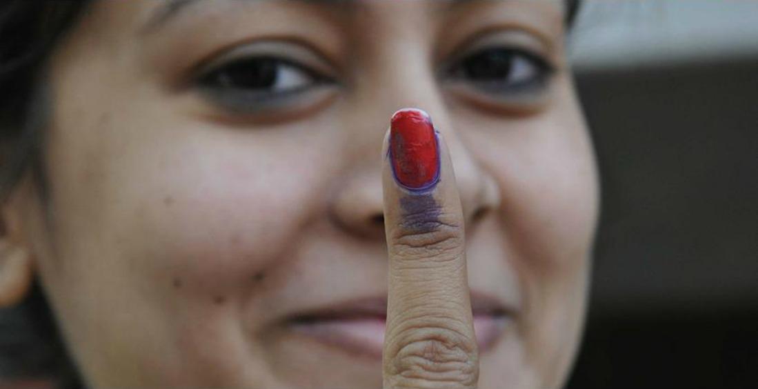 A voter showing inked finger after casting vote