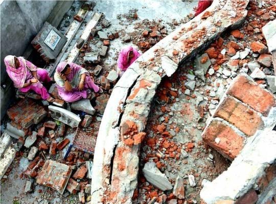 Pakistani home damaged by Indian shells