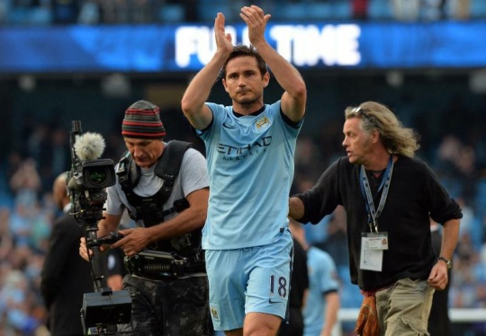 Lampard applauds the Chelsea supporters after the match
