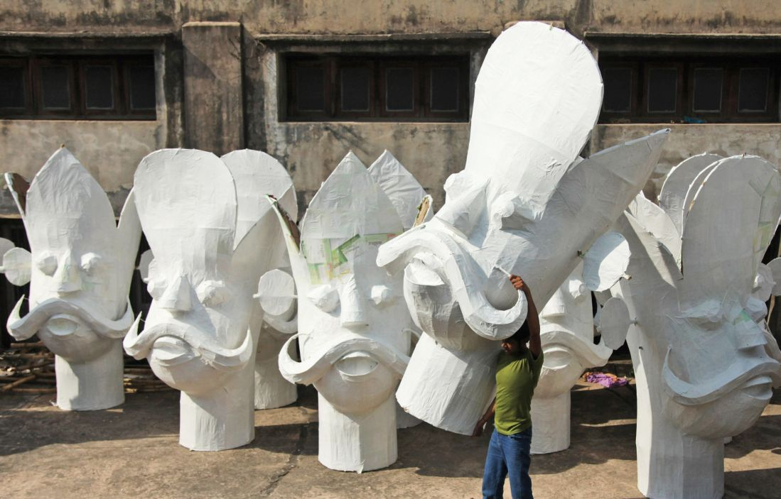 An artisan carries an effigy of Ravana