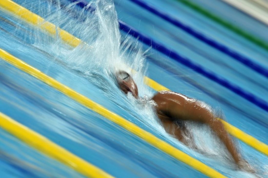 Saurabh Sangvekar competes in the slow heat of the men's 1500m freestyle swimming event during the 17th Asian Games