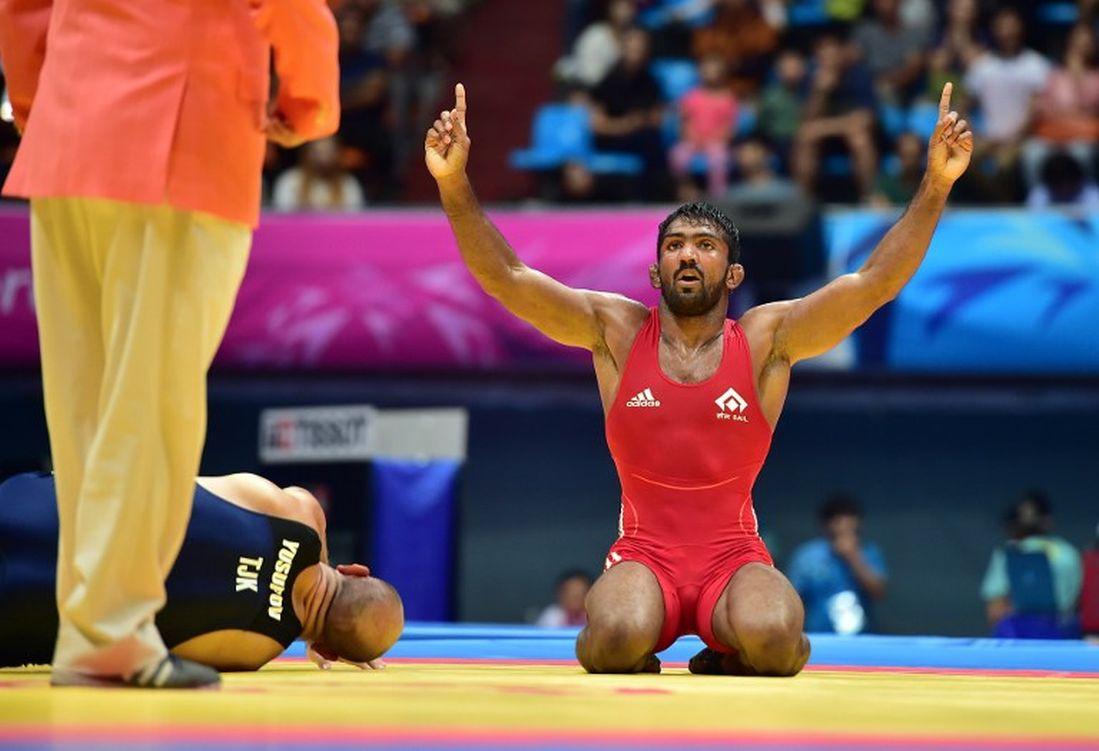 Yogeshwar Dutt reacts after winning the match against Tajikistan's Zalimkhan Yusupov