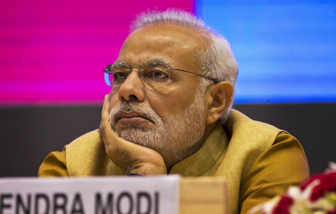 Narendra Modi sits during the launch of the Make in India initiative
