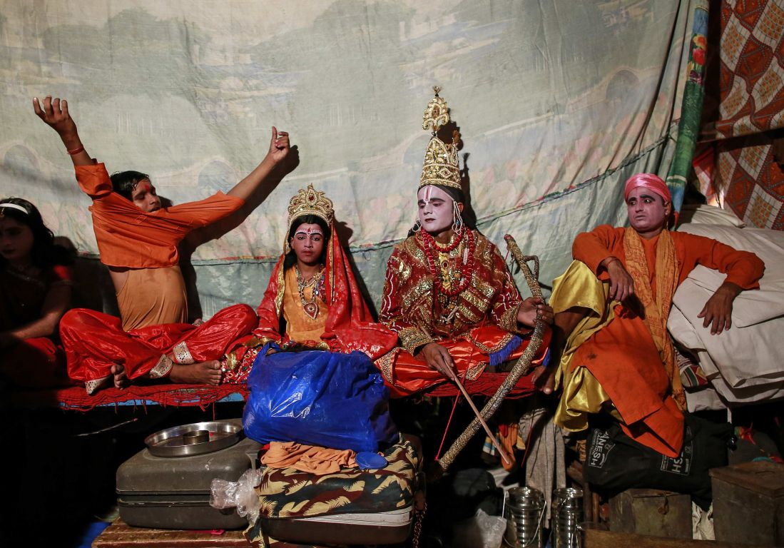Actors wait backstage before their performance for Ramlila