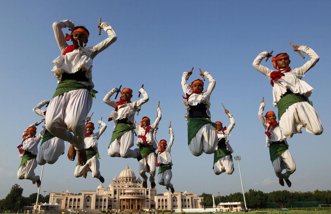 Folk dancers perform Dandiya