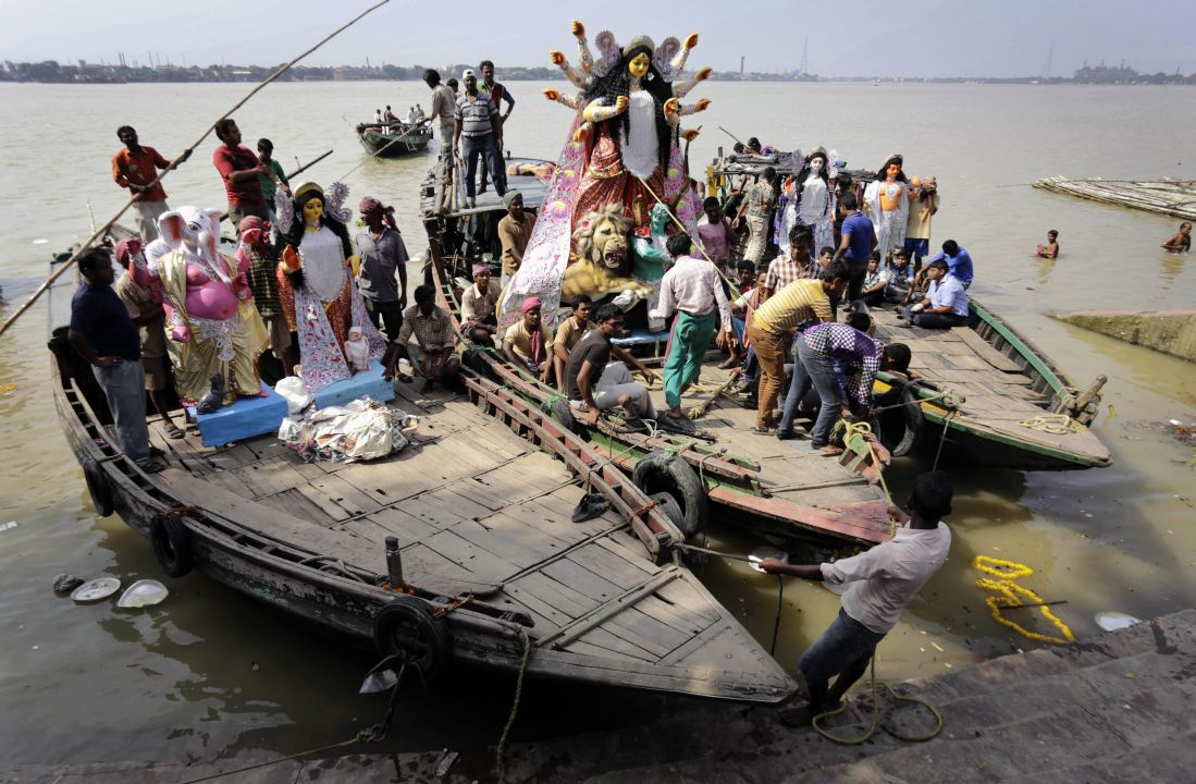 Idols of goddess Durga is carried on a boat