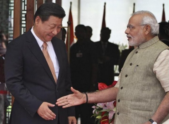 Narendra Modi welcoming Chinese President Xi Jinping upon his arrival in India