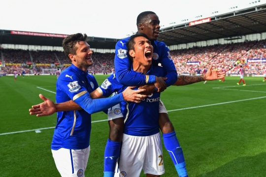 Leonardo Ulloa of Leicester City celebrates scoring the first goal with David Nugent and Jeffrey Schlupp